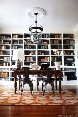 Traditional Dining Room with Pendant light, Built-in bookshelf, Hardwood floors, Crown molding