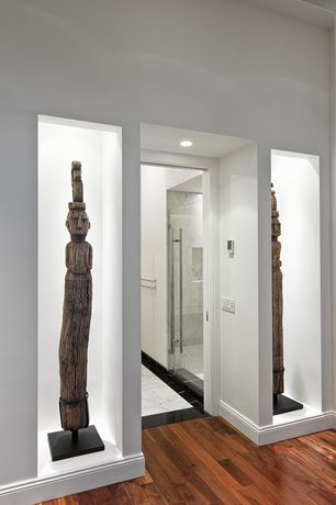 "Contemporary Hallway with French doors, Built-in bookshelf, Carrara (carrera) venato marble 12x12"" honed tile"