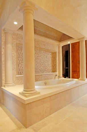 Mediterranean Master Bathroom with Daltile crema marfil classico (tumbled) m722, travertine tile floors, Doric columns
