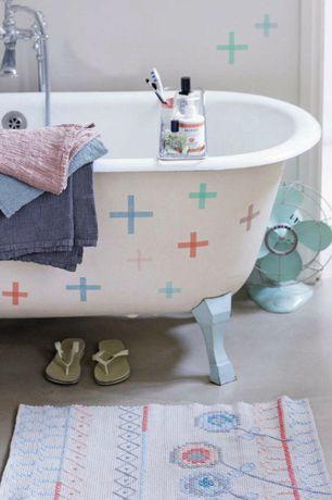 Eclectic Master Bathroom with Concrete floors, Leg tub with custom leg