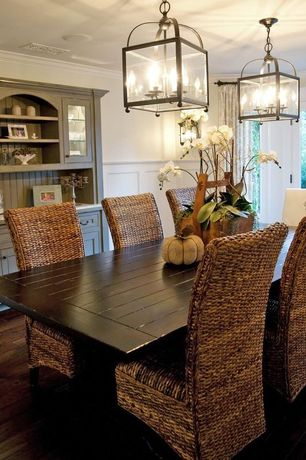 Cottage Dining Room with Hardwood floors, Kosas Collections Ira chair, Wainscotting, Built-in bookshelf, Pendant light