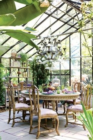 Tropical Dining Room with Rita side chair, Skylight, Concrete tile , Chandelier, Built-in bookshelf