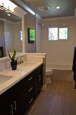 Contemporary Master Bathroom with Pental - pluvium porcelain tile in terra, Wall sconce, Hardwood floors, Built-in bookshelf