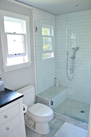 Traditional 3/4 Bathroom with frameless showerdoor, Crown molding, Quartz countertop, Handheld showerhead, Inset cabinets