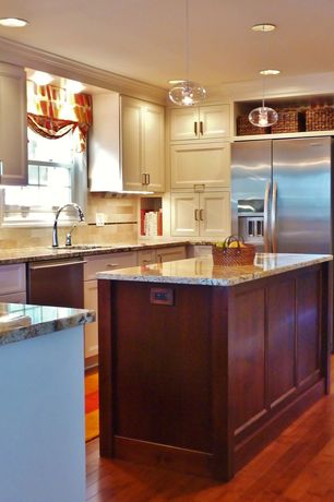 Traditional Kitchen with Pendant light, Undermount sink, Complex granite counters, Stone Tile, Crown molding, Limestone Tile