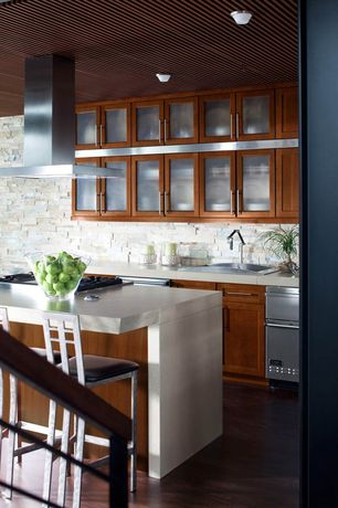Contemporary Kitchen with Flat panel cabinets, Stainless steel counters, Brick stone wall, L-shaped, Subway Tile, Glass panel