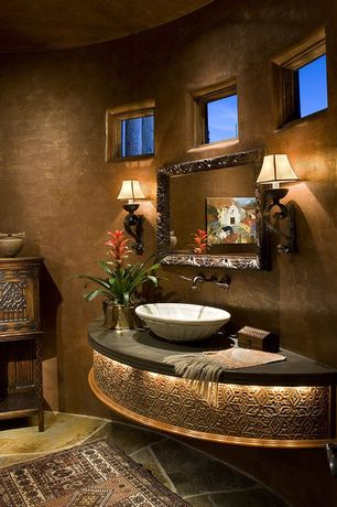 Mediterranean Powder Room with Powder room, Wall sconce, picture window, Flush, specialty door, stone tile floors