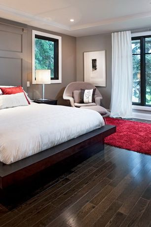 Contemporary Master Bedroom with Hardwood floors, Knoll saarinen large womb chair, Nanimarquina roses rug, Artless sq bed