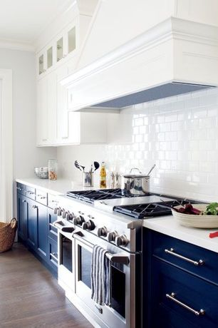 Transitional Kitchen with Hardwood floors, Flush, White subway tile 3x6 glossy, Flat panel cabinets, Crown molding, One-wall