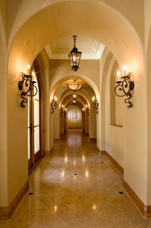 Mediterranean Hallway with High ceiling, Wall sconce, French doors, Crown molding, travertine tile floors, flush light