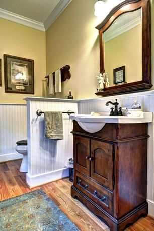 Cottage Full Bathroom with Corian counters, Flat panel cabinets, Inset cabinets, Wainscotting, Simple Granite, Crown molding
