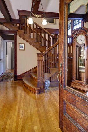 Craftsman Entryway with Glass panel door, Standard height, Hardwood floors, Chandelier, Exposed beam