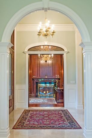 Traditional Hallway with Chandelier, Crown molding, Wainscotting, simple marble floors