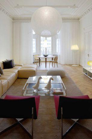 Modern Living Room with Standard height, Crown molding, Hardwood floors, Pendant light, specialty door