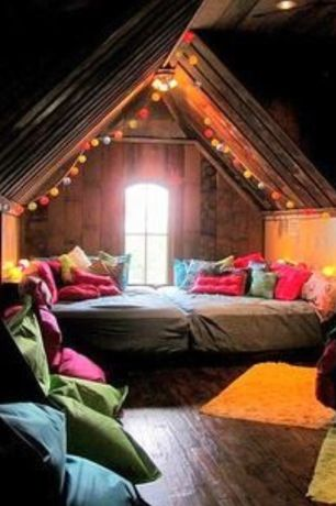 Eclectic Guest Bedroom with Arched window, Standard height, flush light, Hardwood floors