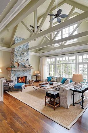 Cottage Living Room with Transom window, Knotted net round glass table lamp, stone fireplace, High ceiling, Ceiling fan