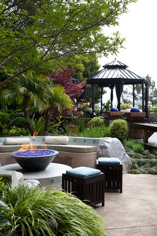 Modern Patio with Fence, Fire pit, exterior tile floors, Pathway