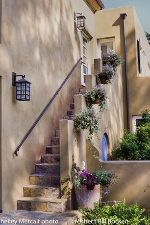 Mediterranean Landscape/Yard with Exterior stone steps, Stucco wall, Smart solar mission solar lantern, Private yard