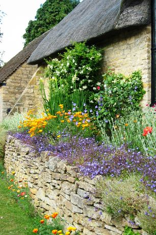 Cottage Landscape/Yard with Huckleberry Wall Stone, Raised beds, Cottage garden, dry stack wall