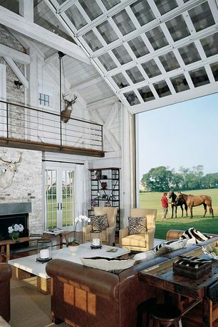 Country Living Room with Brick wall, Thatcher Leather Wingback Chair, Cathedral ceiling, Loft, Leather sofa, specialty door