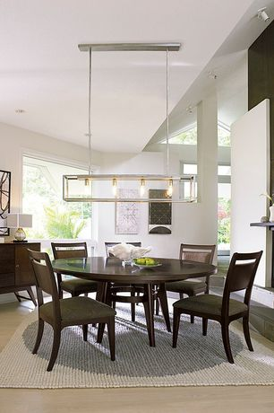 Contemporary Dining Room with Hardwood floors, High ceiling, Pendant light