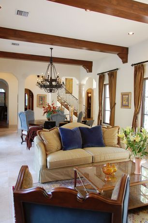 Mediterranean Great Room with Columns, Chandelier, Concrete tile , Exposed beam, Standard height, can lights, Casement