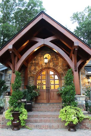 Craftsman Front of Home with Brick patio, Arts and crafts style door with sidelights