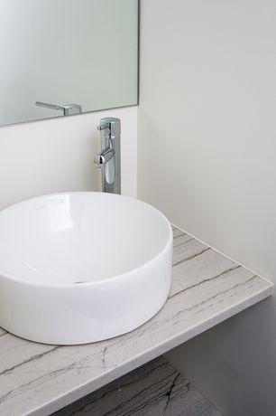 Modern Powder Room with Standard height, Vessel sink, Travertine counters, travertine floors, Powder room