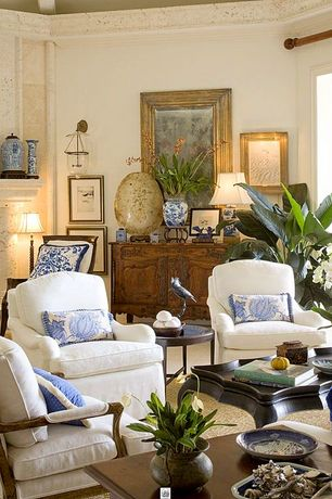 Traditional Living Room with Paint 1, High ceiling, limestone floors, Cement fireplace, Fireplace, Wall sconce