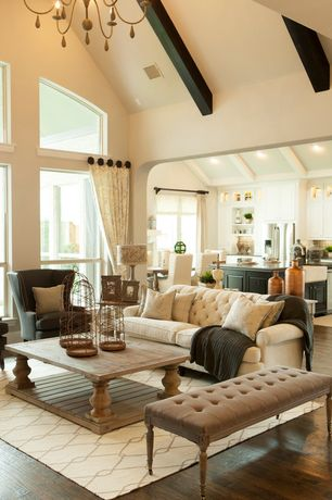 Traditional Living Room with Exposed beam, Restoration hardware 17th c. monastery coffee table, High ceiling, Hardwood floors
