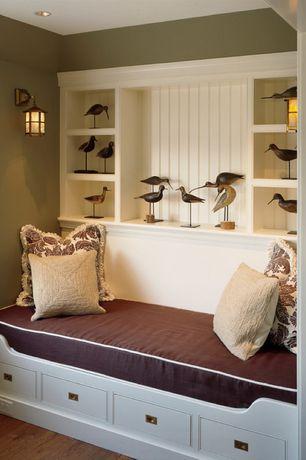 Cottage Living Room with Beadboard panel, Hardwood floors, Built-in bookshelf, Wall sconce