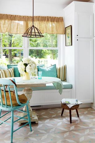 Cottage Dining Room with Standard height, Carpet, Pendant light, double-hung window, Window seat