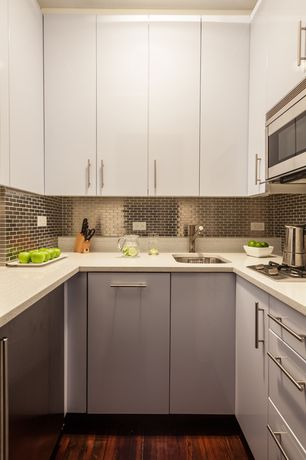 Modern Kitchen with 2 in. Solid Surface Countertop in Ivory White, Hardwood floors, Limestone counters, Subway Tile, Flush