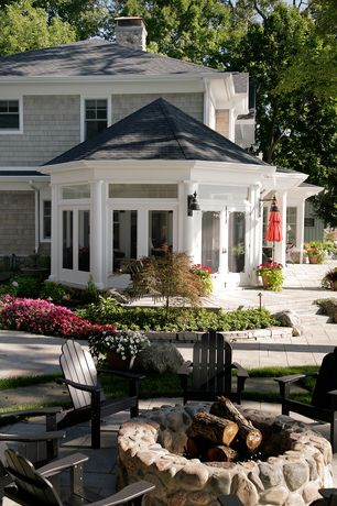 Traditional Patio with Fire pit, Cedar shingle siding, exterior stone floors, Sunroom
