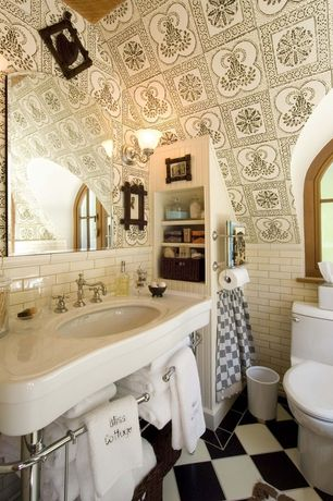 Powder Room with Corian counters, Beadboard, Newport brass: 7300 widespread lavatory faucet, Porcelain schoolhouse sink
