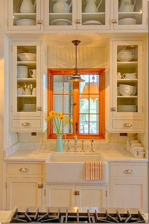 Cottage Kitchen with Inset cabinets, electric cooktop, Farmhouse sink, Nickel bin pull, European Cabinets, Pendant light