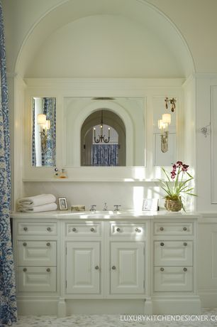 Traditional Master Bathroom with Chandelier, Inset cabinets, ceramic tile floors, Simple marble counters, Master bathroom