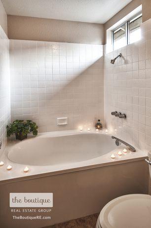 Traditional Full Bathroom with Full Bath, tiled wall showerbath, shower bath combo, Casement, stone tile floors, Bathtub