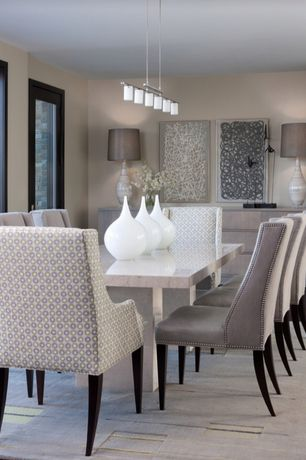Contemporary Dining Room with INSPIRE Q Jourdan Grey Link Sloped Arm Hostess Chair, Pendant light, Concrete floors