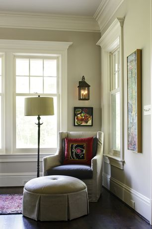 Traditional Living Room with Wingback Swivel Glider with Slipcover, Crown molding, Wall sconce, Hardwood floors