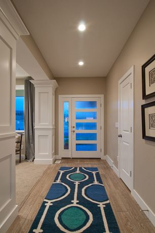 Contemporary Entryway with Columns, Paint 2, Safavieh dhurries navy / ivory runner, six panel door, Hardwood floors, Paint 1