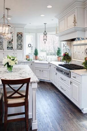 Traditional Kitchen with Raised panel, Oak flooring, Glass panel, Kitchen island, Breakfast bar, Pendant light, L-shaped