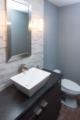 Contemporary Powder Room with Vessel sink, Wall sconce, full backsplash, Paint 1, Subway Tile, limestone tile floors, Flush