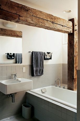 """Rustic Full Bathroom with Corian counters, limestone floors, 4""""x4"""" mist gray tile, Wall mounted sink"""
