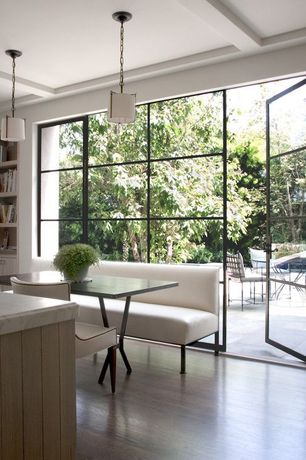 Contemporary Dining Room with Pendant light, Exposed beam, Jan Showers Palm Beach Banquette, French doors, Hardwood floors