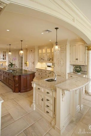 Traditional Kitchen with Antiqued white maple cabinetry, Armoire style refrigerator panel, French doors, Raised panel