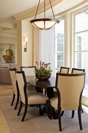 Traditional Dining Room with Wall sconce, simple marble tile floors, flush light, Standard height, can lights, Crown molding
