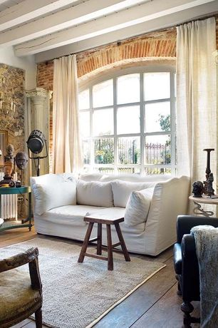"""Eclectic Living Room with Exposed beam, Hardwood floors, Arched window, United general supply 28"""" saddle stool, Columns"""