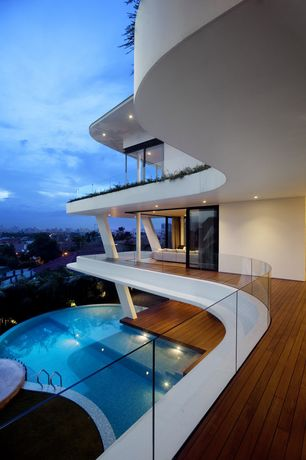 Contemporary Porch with Raised beds, Wrap around porch, Infinity pool, Pathway