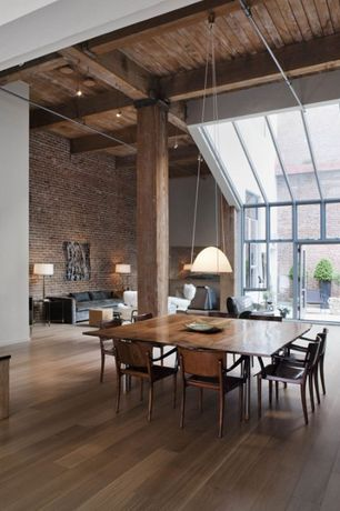 Contemporary Dining Room with High ceiling, Pendant light, Transom window, flat door, picture window, Exposed beam, Columns